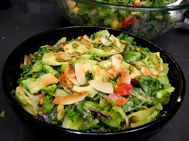 Luau Kale Salad with homemade creamy orange coconut dressing. High Raw. Vegan & Soy Free